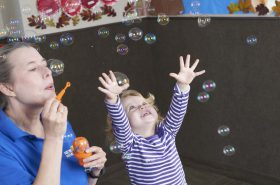 Toddlers Blowing Bubbles